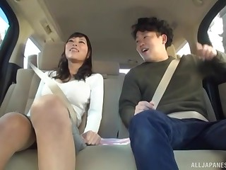 Naughty Japanese spoil spreads her trotters to get pussy fingered in a car