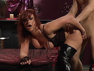 Redhead in hush up boots Nikki Hunter swallows cum after a doggy fuck