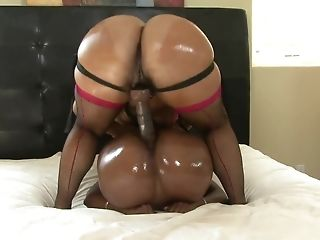 Ebony lezzies with elastic backsides use strapon playthings in sofa best sex
