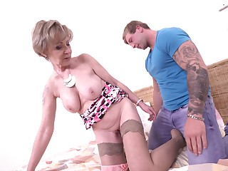 Tattooed amateur dude bangs mature granny Maris on along to bed