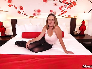 Skinny brunette milf to saggy tits, Judith, is riding a hard ashen cock for a camera