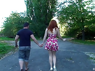 Stunning redhead Barbara Babeurre plays with a heavy cock outdoors